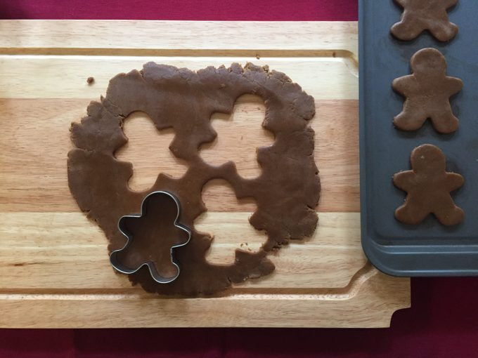 making gingerbread cookies cutting out gingerbread men from cookie dough
