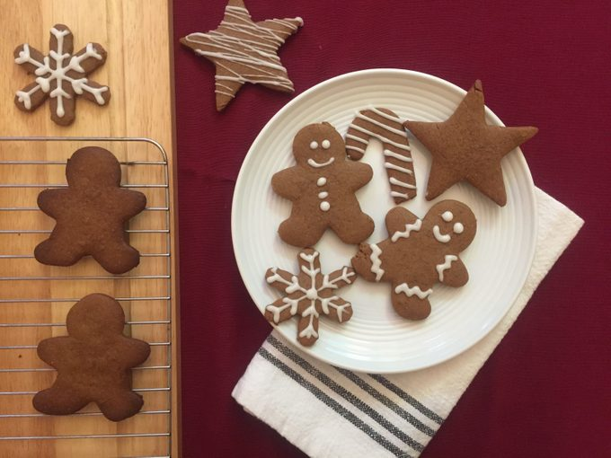 gingerbread cookies on plate and cooling on a rack