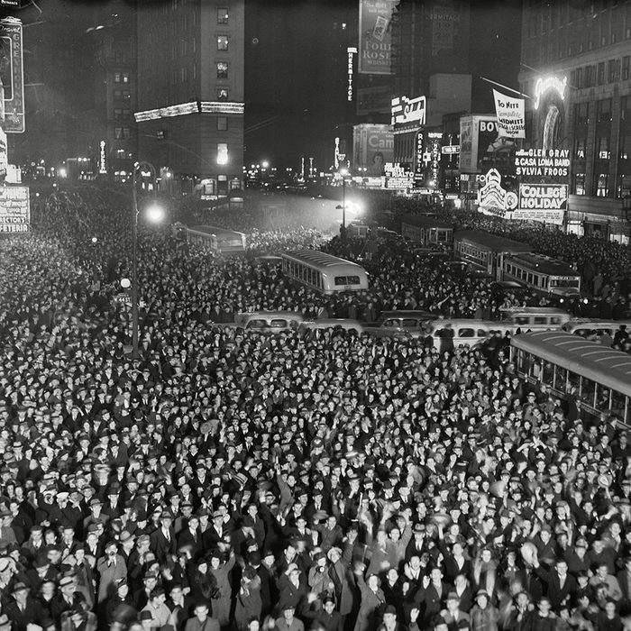 This is a general view of Times Square as vast throngs jammed it early today to ring in 1937