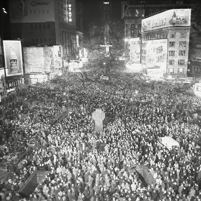 """Jam-packed Times Square in New York was made exactly, as New Yorkers thronged the """"white way"""" to welcome 1946. The view is from 47th Street and Broadway, looking south New Years in Times Square, New York, USA"""