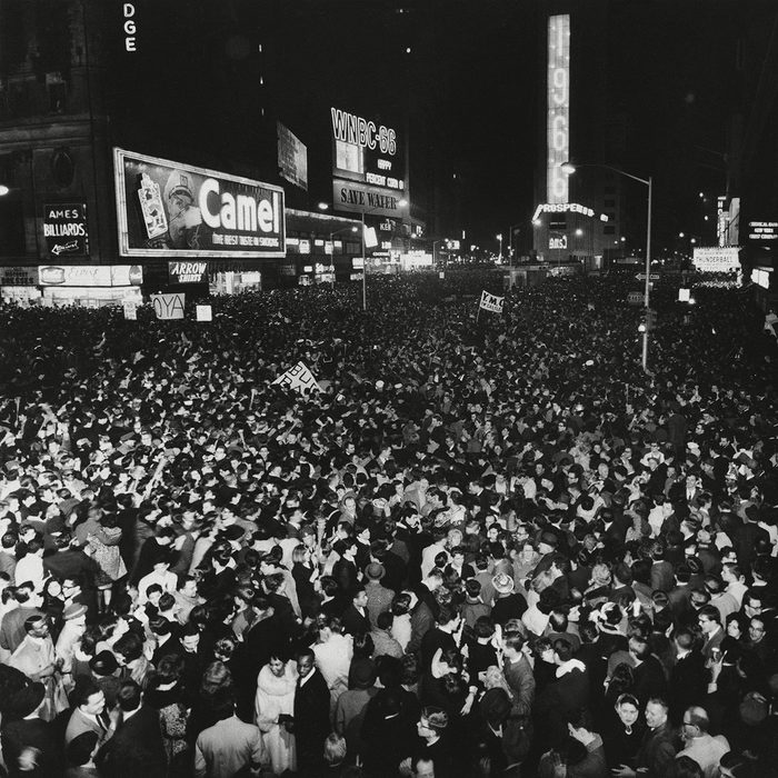 """A wall-to-wall crowd fills New York's Times Square as """"1966"""" is flashed on the front of the Allied Chemical tower at the stroke of midnight and the old year ends, . The tower is the former Times Tower with a new facade of white marble making its debut to a New Years Eve crowd"""