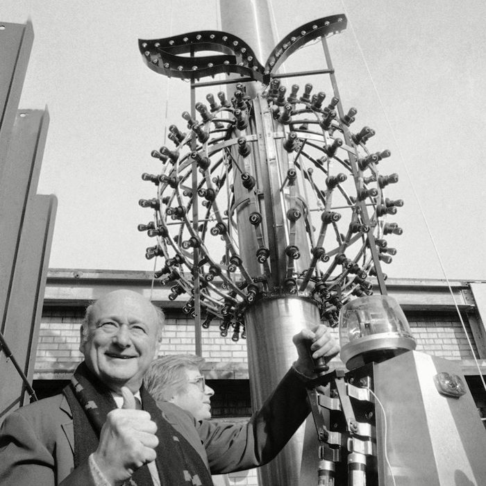 New York City Mayor Ed Koch gives the thumbs up sign as he flips a switch to test the Big Apple Ball, in New York. The mayor was helping to test the red and green lighted apple which will descend on Times Square this New Year?s Eve. The tradition of the ball was established in 1907