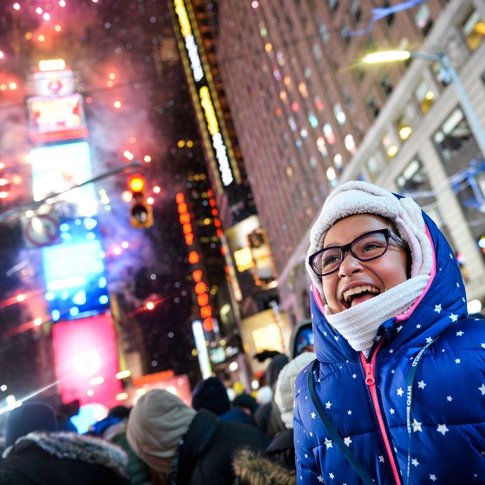 Maylynn Rodriguez cheers after the countdown in Times Square during the New Year's celebration early, in New York