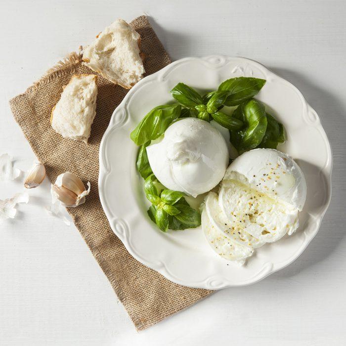 Italian burrata and mozzarella with pepper, olive oil and bread.