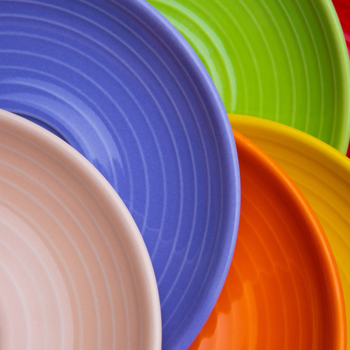 Collection of colorful red, green, blue, orange, biege dishes on white background