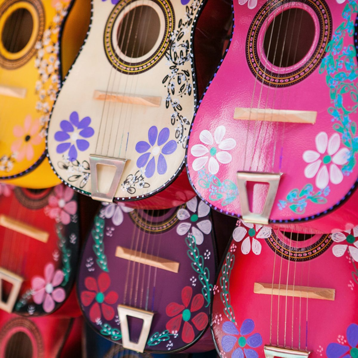 Colorful traditional Mexican guitars on market.
