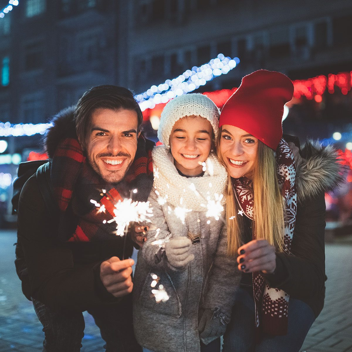 Family with daughter enjoying New Year