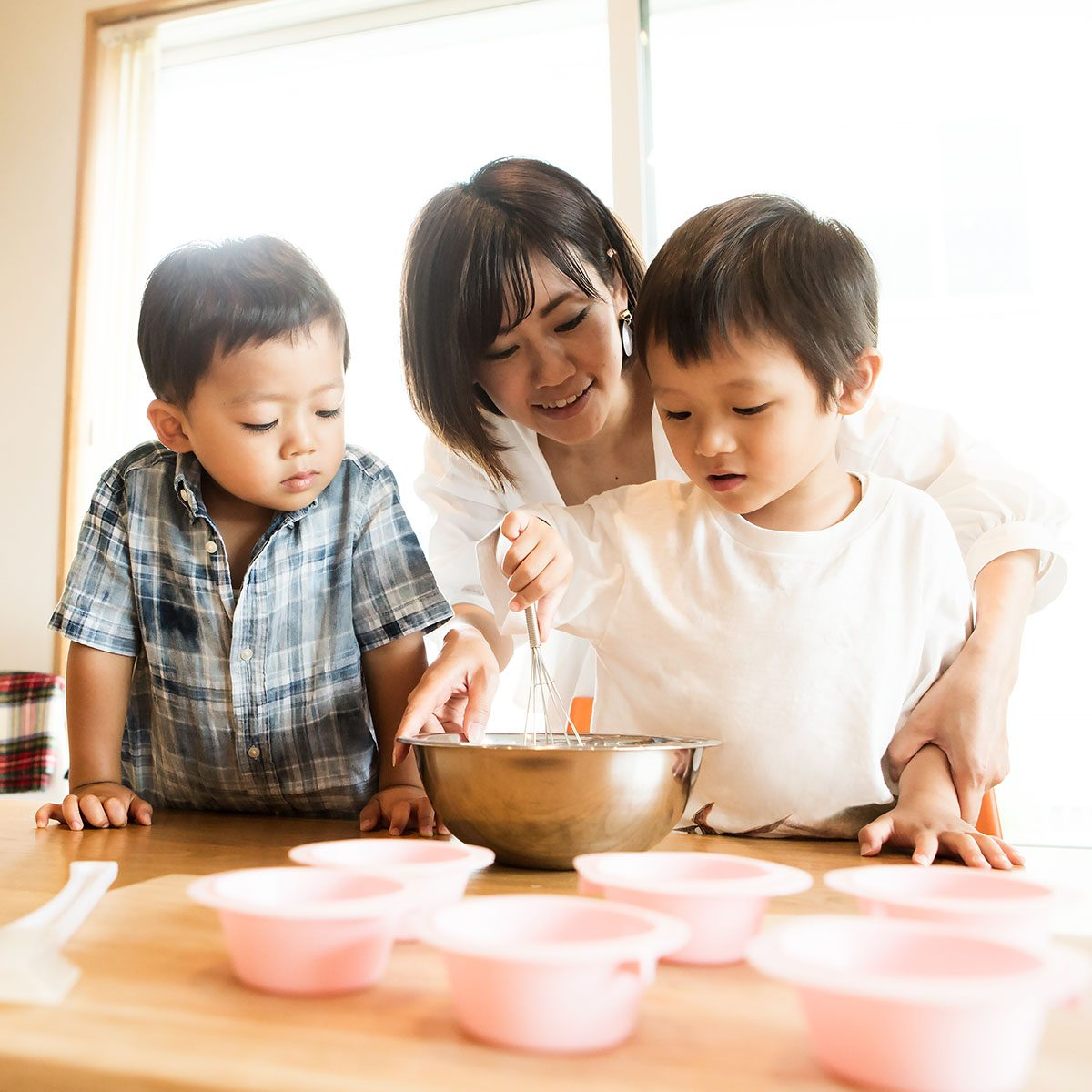 Mother and son cooking together - new years activities for kids