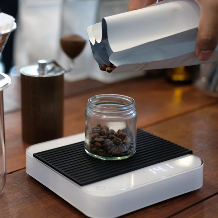 Weighing coffee on a scale