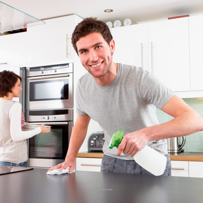 Man cleaning counters