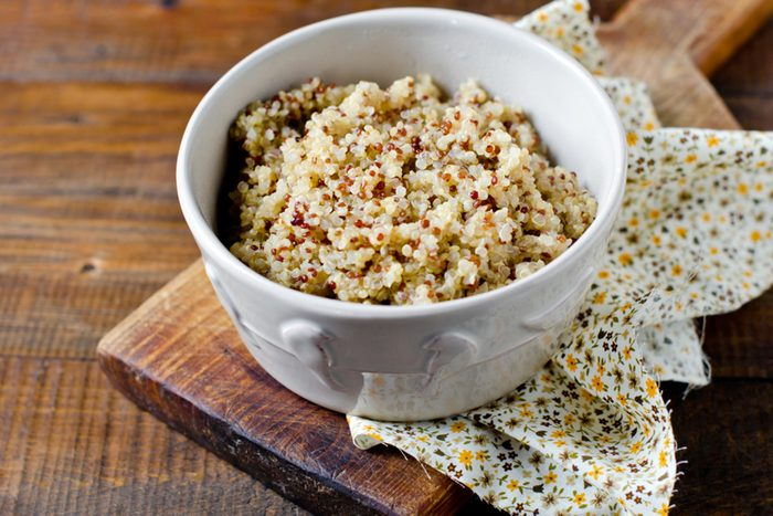 Boiled quinoa in a bowl on a wooden table