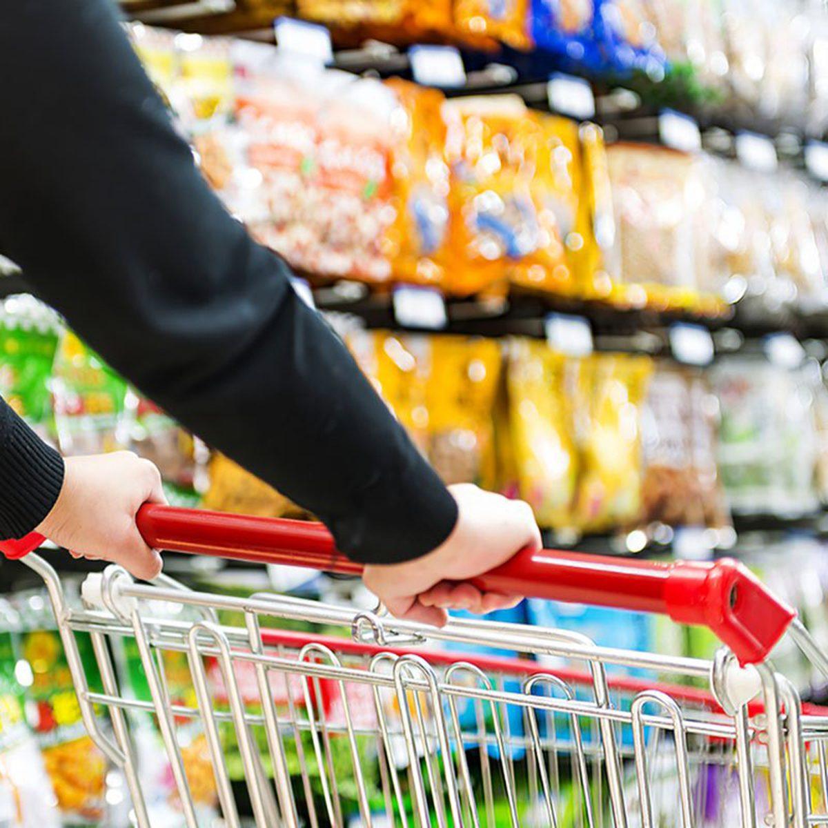 Person pushing a shopping cart