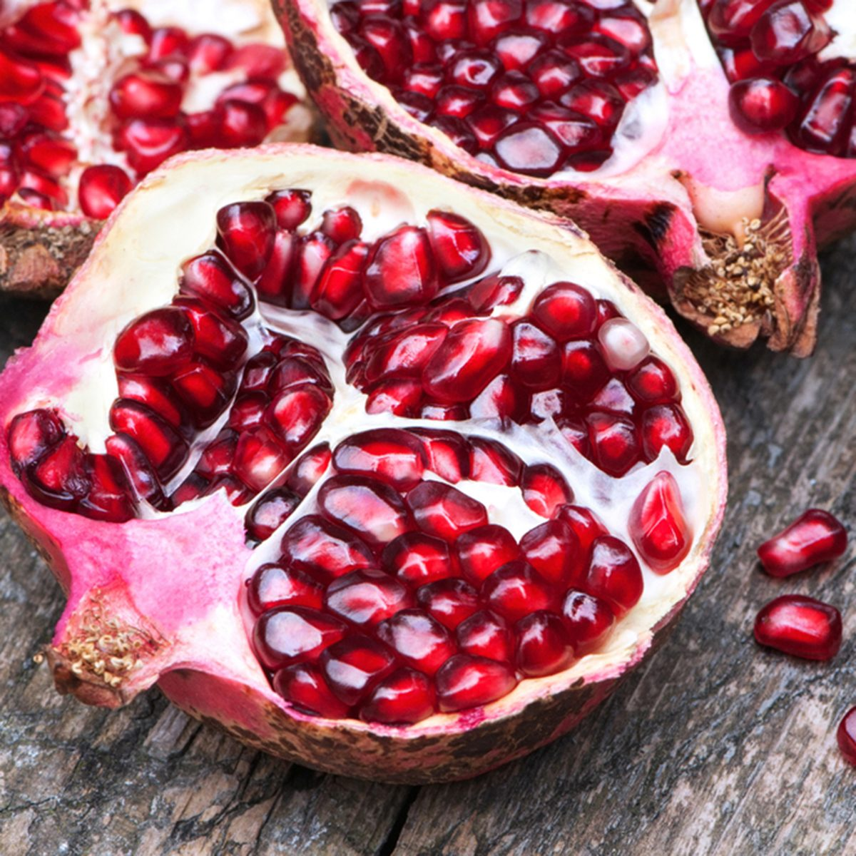 Juicy pomegranates on wood