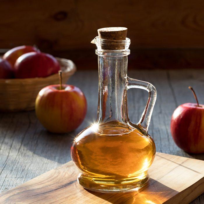 A bottle of apple cider vinegar in the morning sun