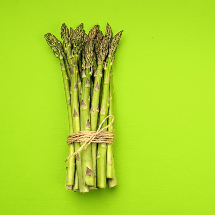 Food background asparagus flat lay pattern.