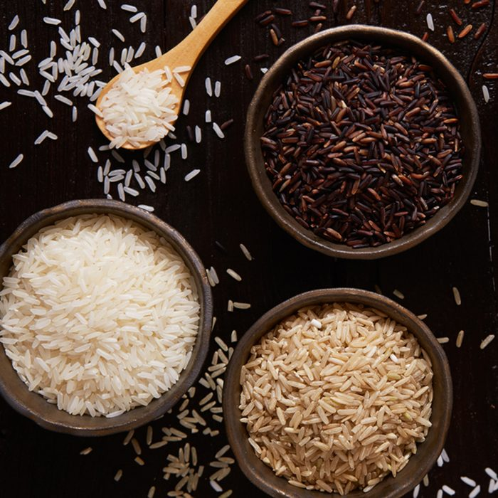 Jasmine rice, Brown rice, Red rice,Black rice, Mixed rice and Riceberry on rustic table