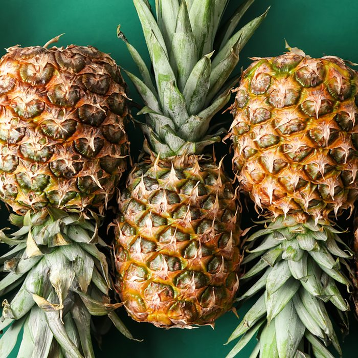 Ripe pineapples on color background