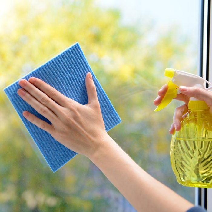 Hands with spray cleaning the window; Shutterstock ID 169518110; Job (TFH, TOH, RD, BNB, CWM, CM): TOH