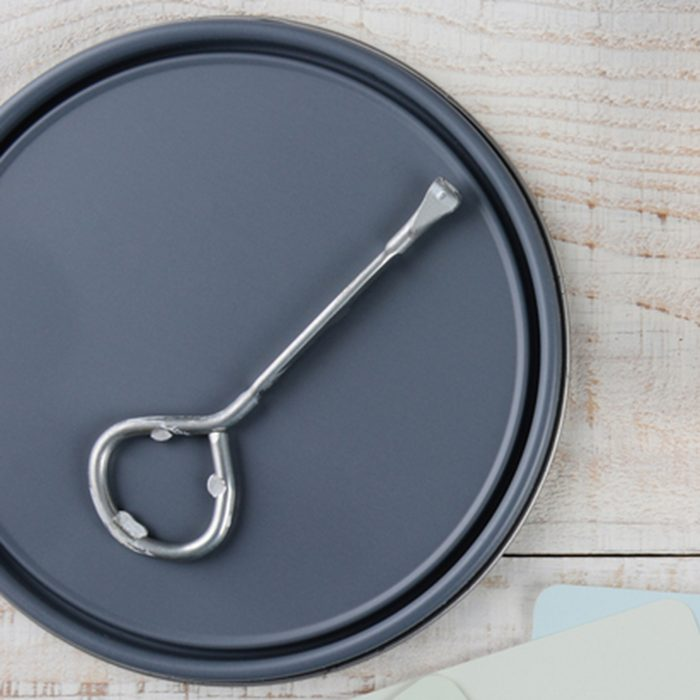 Overhead shot of a paint can lid, opener, color samples and paint brush on a rustic wooden surface. Horizontal format with copy space. ; Shutterstock ID 242845189; Job (TFH, TOH, RD, BNB, CWM, CM): TOH
