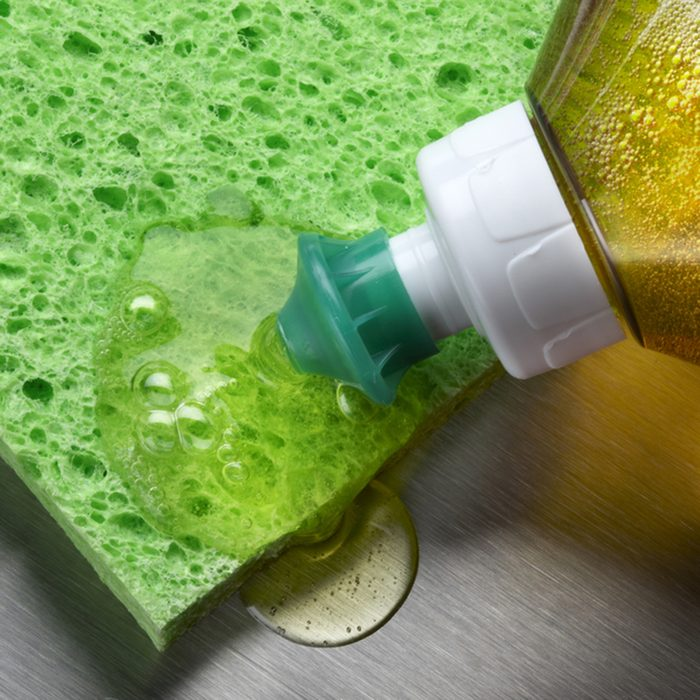 macro shot of dish soap being squeezed onto green sponge in aluminum sink; Shutterstock ID 57254341; Job (TFH, TOH, RD, BNB, CWM, CM): TOH