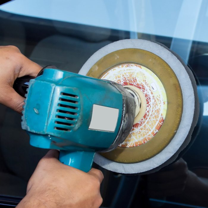 Car Glass polishing with power buffer machine. CAR CARE images. closeup Useful as background for design-works.; Shutterstock ID 89574067; Job (TFH, TOH, RD, BNB, CWM, CM): TOH