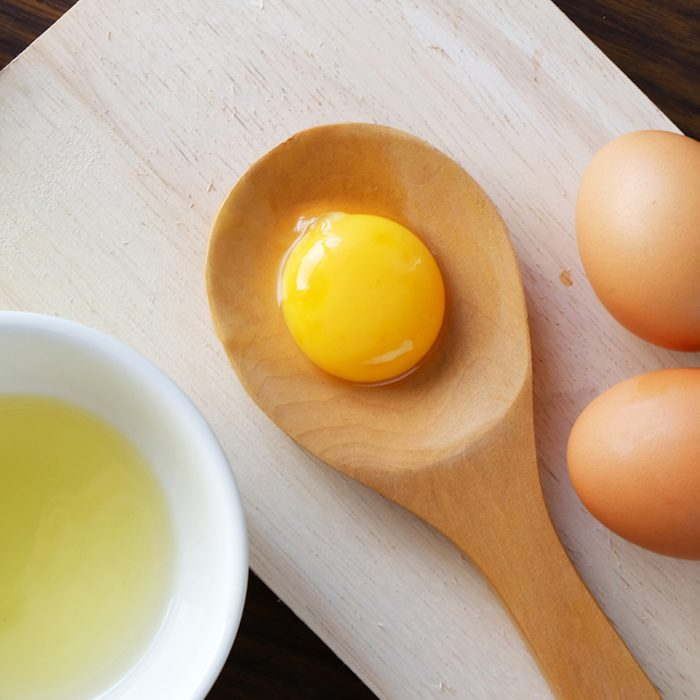 separated egg white and yolk; Shutterstock ID 363403886