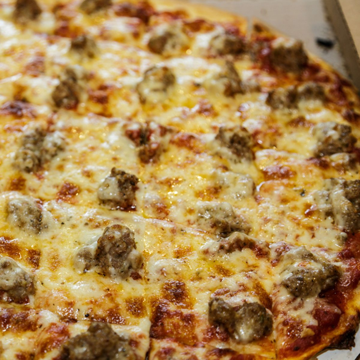Hot Sausage Pizza in Take Out Box