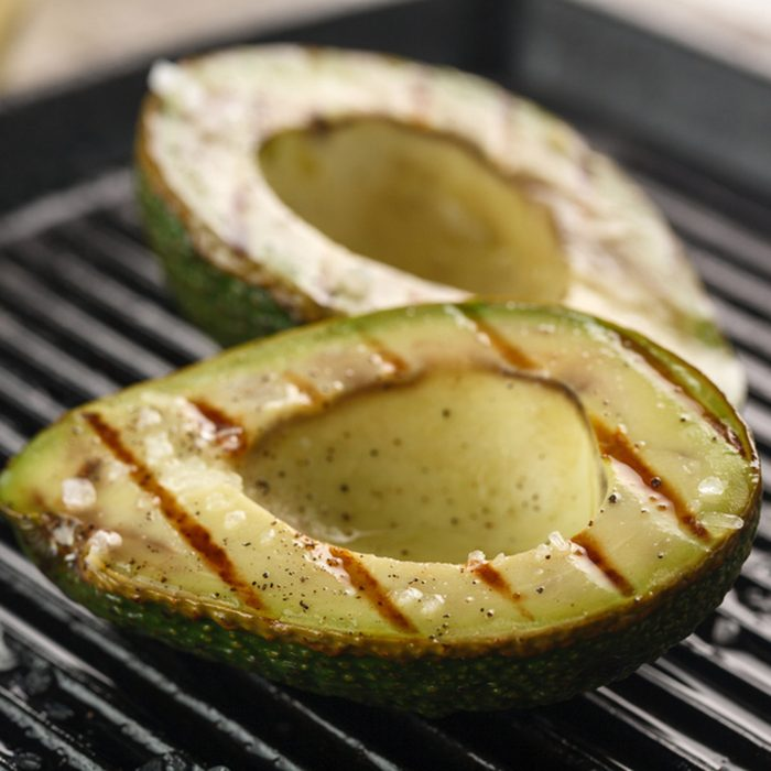 sliced fresh avocado on the grill.