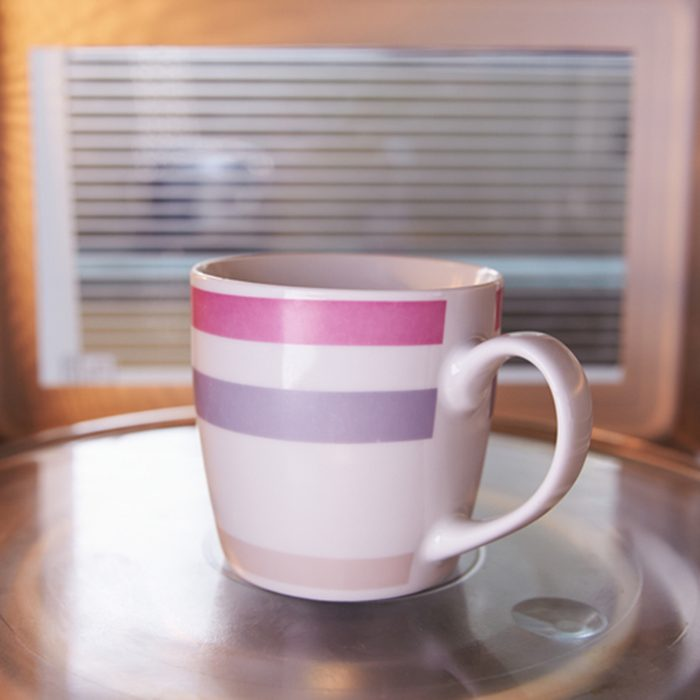 Warming Cup Of Coffee Inside Microwave Oven; Shutterstock ID 234672856; Job (TFH, TOH, RD, BNB, CWM, CM): TOH