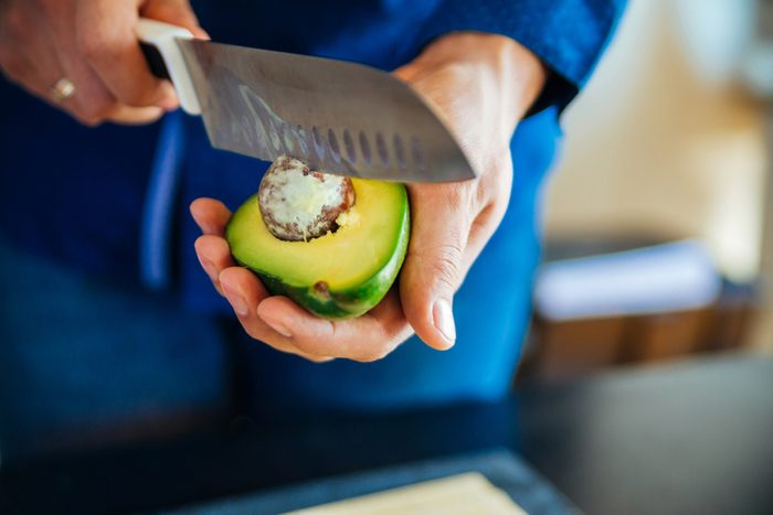 Person Showing How to Cut an Avocado
