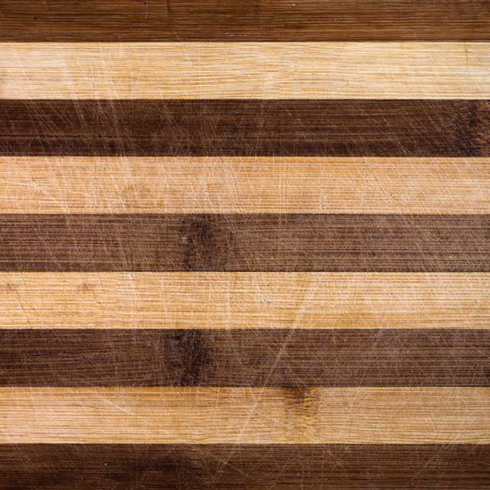 Wooden cutting board with knife marks