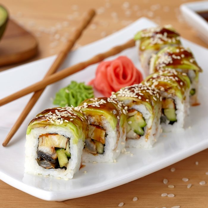 Green dragon sushi roll with eel, avocado, cucumber, wasabi and ginger.