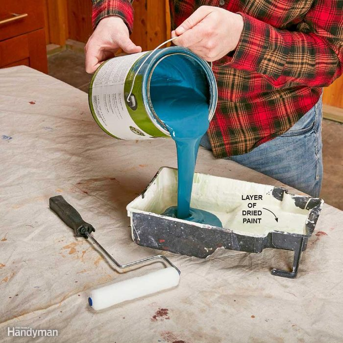 Pouring paint into a tray