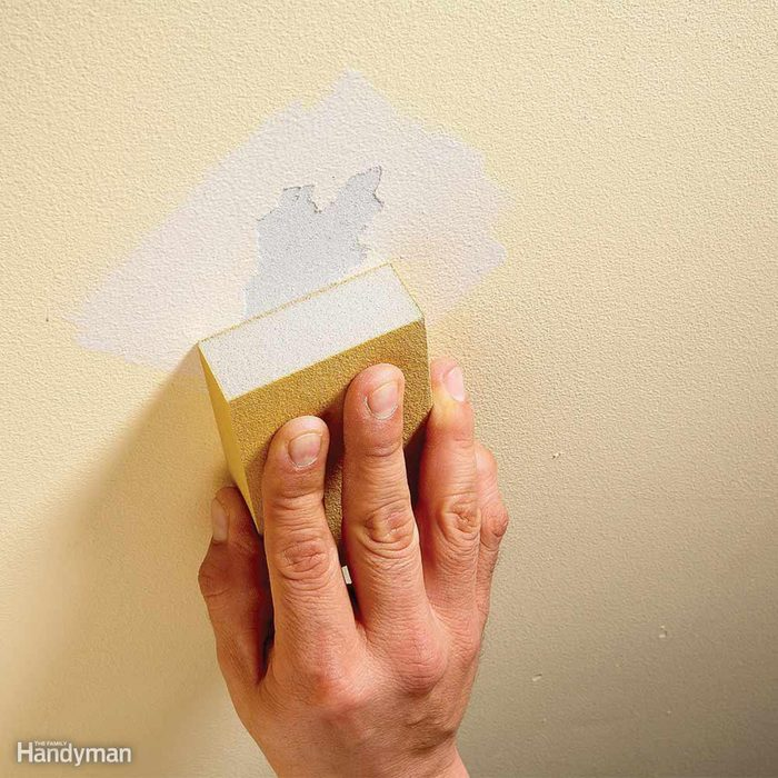 Sanding over a defect in the wall