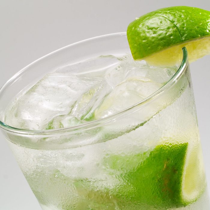 Gin Rickey cocktail isolated on gray background
