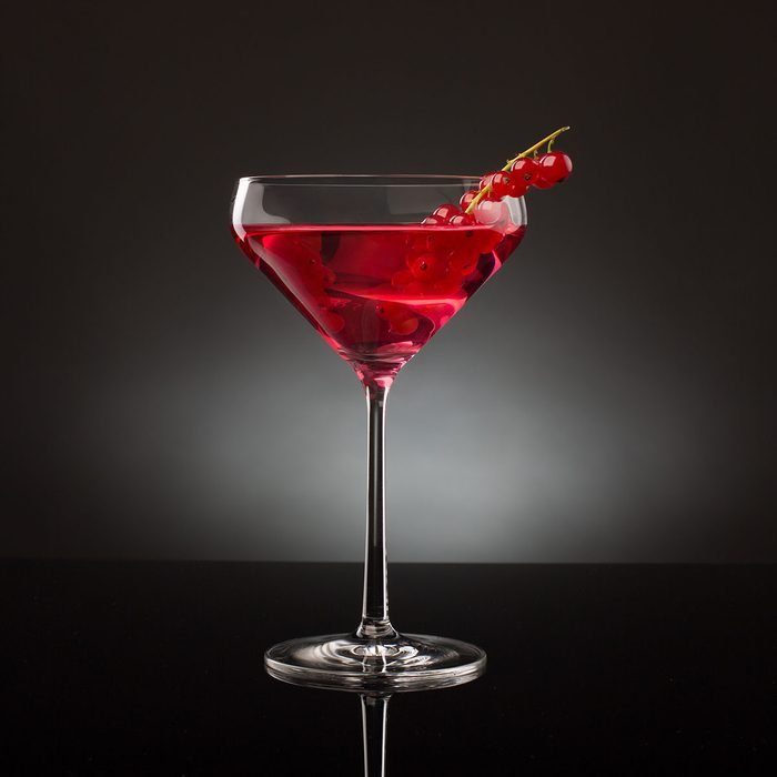 Red Cocktail with Berries on Dark Background