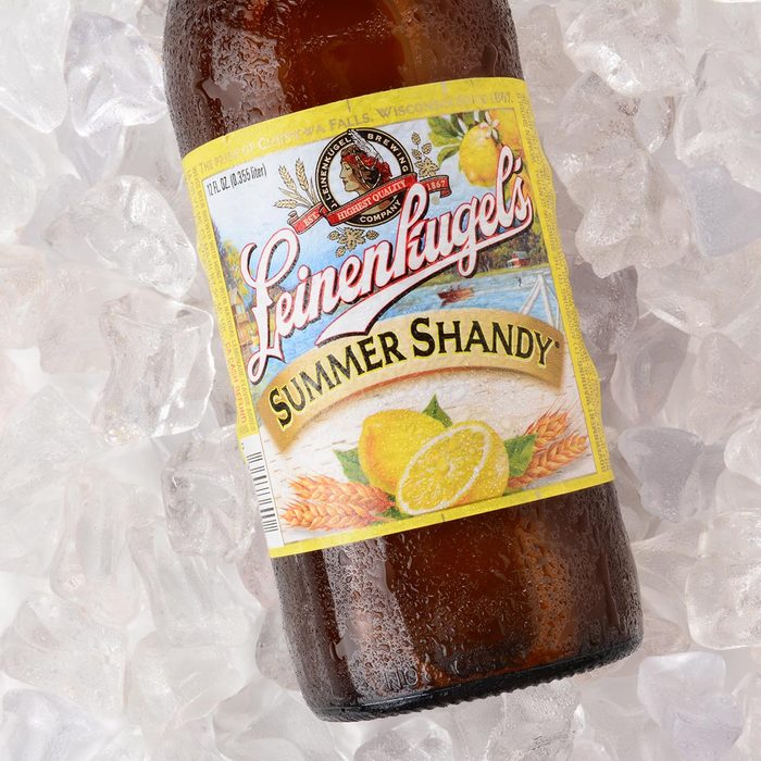 A bottle of Leinenkugel Summer Shandy on a bed of ice.