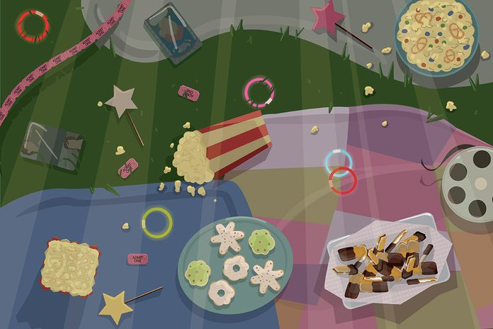 Illustration of popcorn and other treats spread upon scattered blankets on the grass. It is a night scene with light from a unseen movie projector over the whole image
