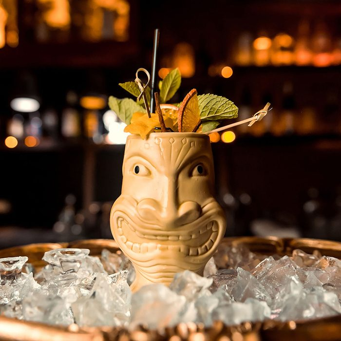 Exotic cocktail rum runner in an unusual glass stands on a bar in a pub