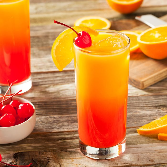 Juicy Orange and Red Tequila Sunrise with a Cherry