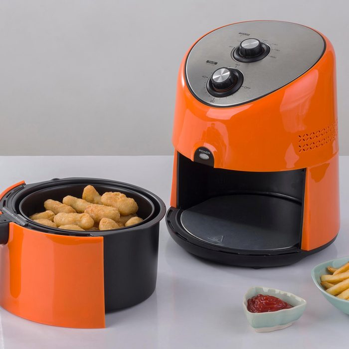 Air fryer machine with chicken and french fried