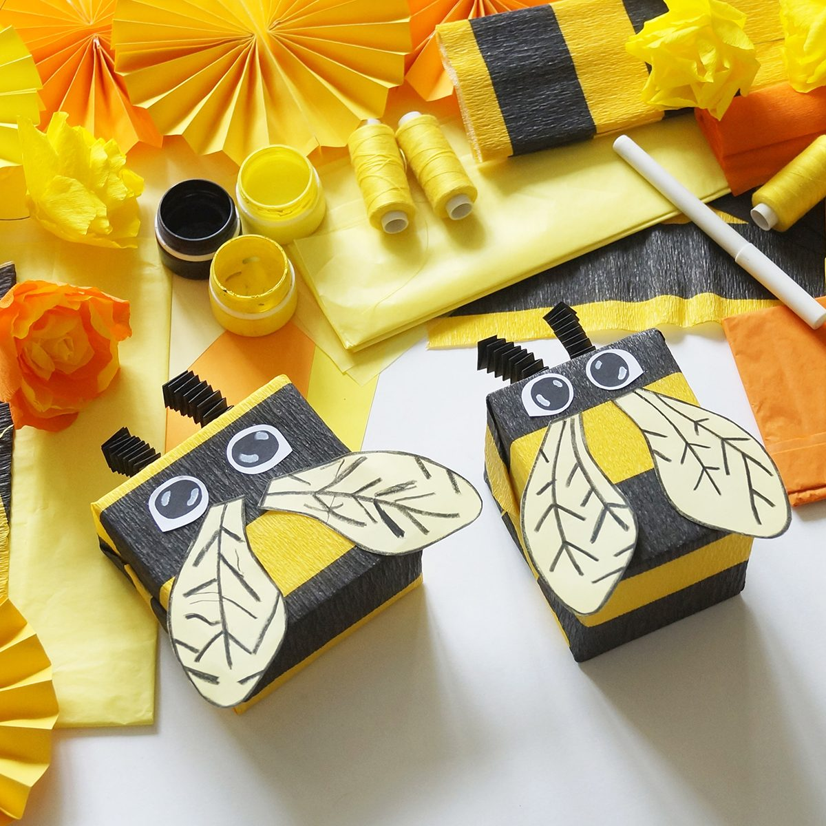 The child loves crafts bee. The child's hands. Gift packing. Materials for creativity.
