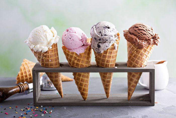 Variety of frozen custard or ice cream scoops in cones