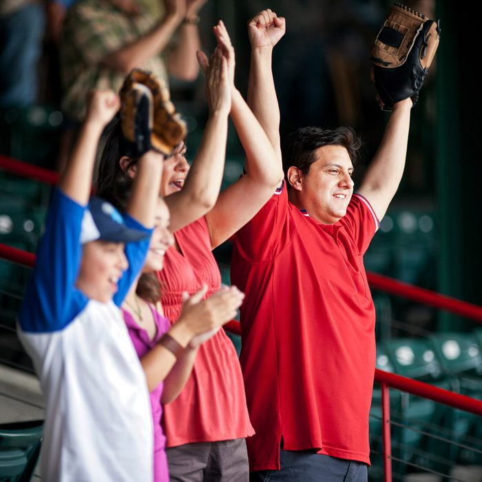 Family cheering on a baseball game at a sports stadium.; Shutterstock ID 1285189399; Job (TFH, TOH, RD, BNB, CWM, CM): Taste of Home