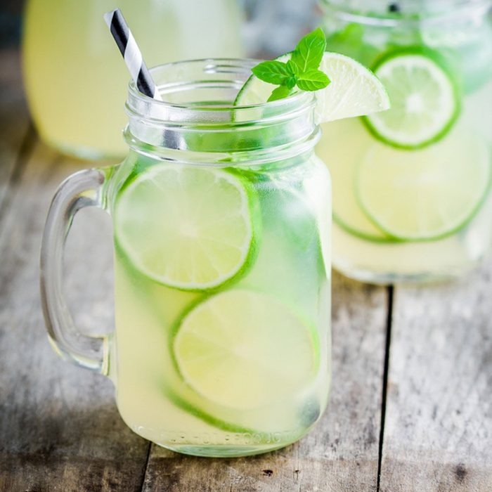 Drink in a glass jar with a handle and striped straw.