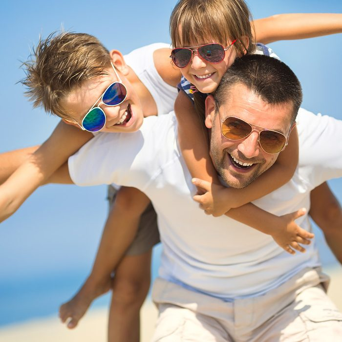 Father with children having fun on the beach at the day time.; Shutterstock ID 324364430; Job (TFH, TOH, RD, BNB, CWM, CM): Taste of Home