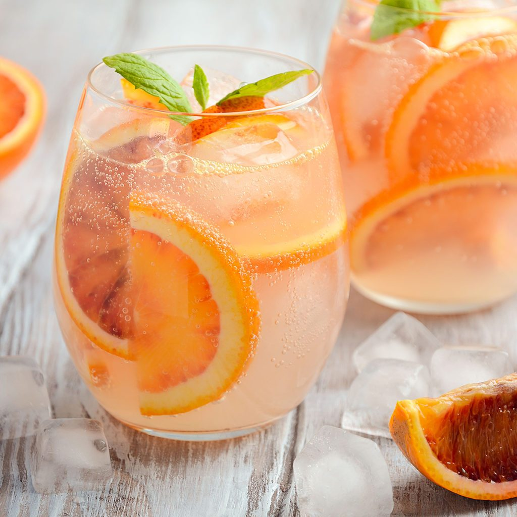 Cold refreshing drink with blood orange slices in a glass on a wooden background. Selective focus.; Shutterstock ID 608945540; Job (TFH, TOH, RD, BNB, CWM, CM): Taste of Home
