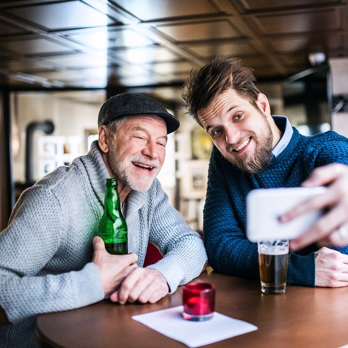 Senior father and his young son with smartphone in a pub.; Shutterstock ID 777880687; Job (TFH, TOH, RD, BNB, CWM, CM): Taste of Home
