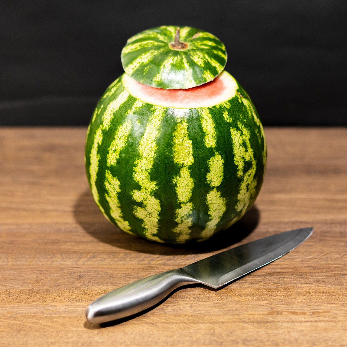 Watermelon on a wooden table.