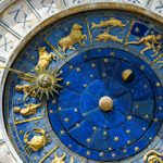 Ancient clock Torre dell'Orologio in San Marco Square, Venice, Italy. Detail with Zodiac signs. Historical landmark and travel attraction of Venice. Astrological vintage
